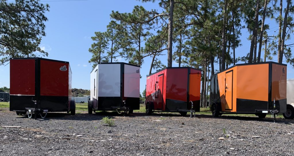 Many brands, many colors of enclosed trailers.